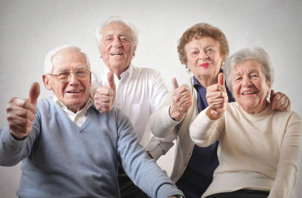 Senior people with thumbs up